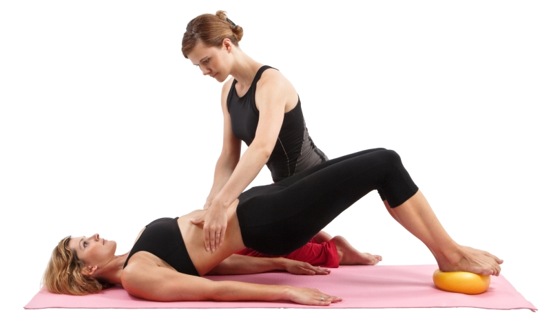 Pilates Instructor Helping